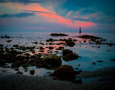 Photo of Cranfield beach Lighthouse during sunset. Newcastle, County Down, Northern Ireland.